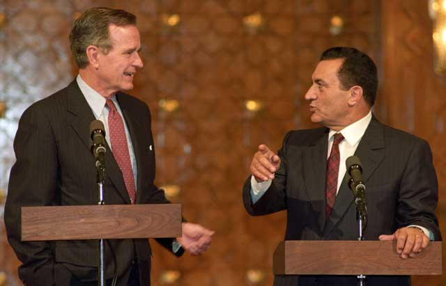 Egypt's President Mubarak and U.S. President George Bush Sr. speaking at a joint press conference in Cairo on 23rd of November, 1990