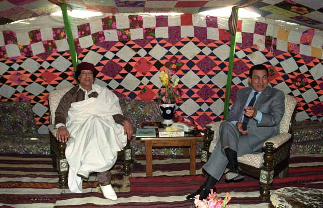 Mubarak patching differences with his old foe Moamar Gadafi during a meeting, inside a tent, at the Egyptian border town of Sidi Barani on 22nd of April, 1992. Ph. Norbert Schiller
