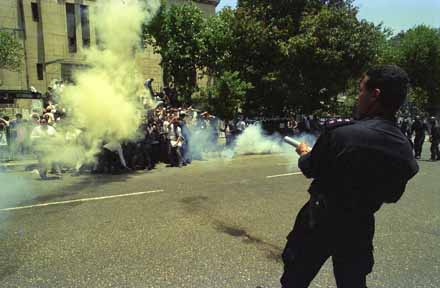 Egyptian police fires teargas into a crowd of lawyers protesting against the death of Abdel Harith Madani, a fellow attorney with Islamist ties who defended Islamic militants and died while in police custody. 17th of May 1994. Ph. Norbert Schiller