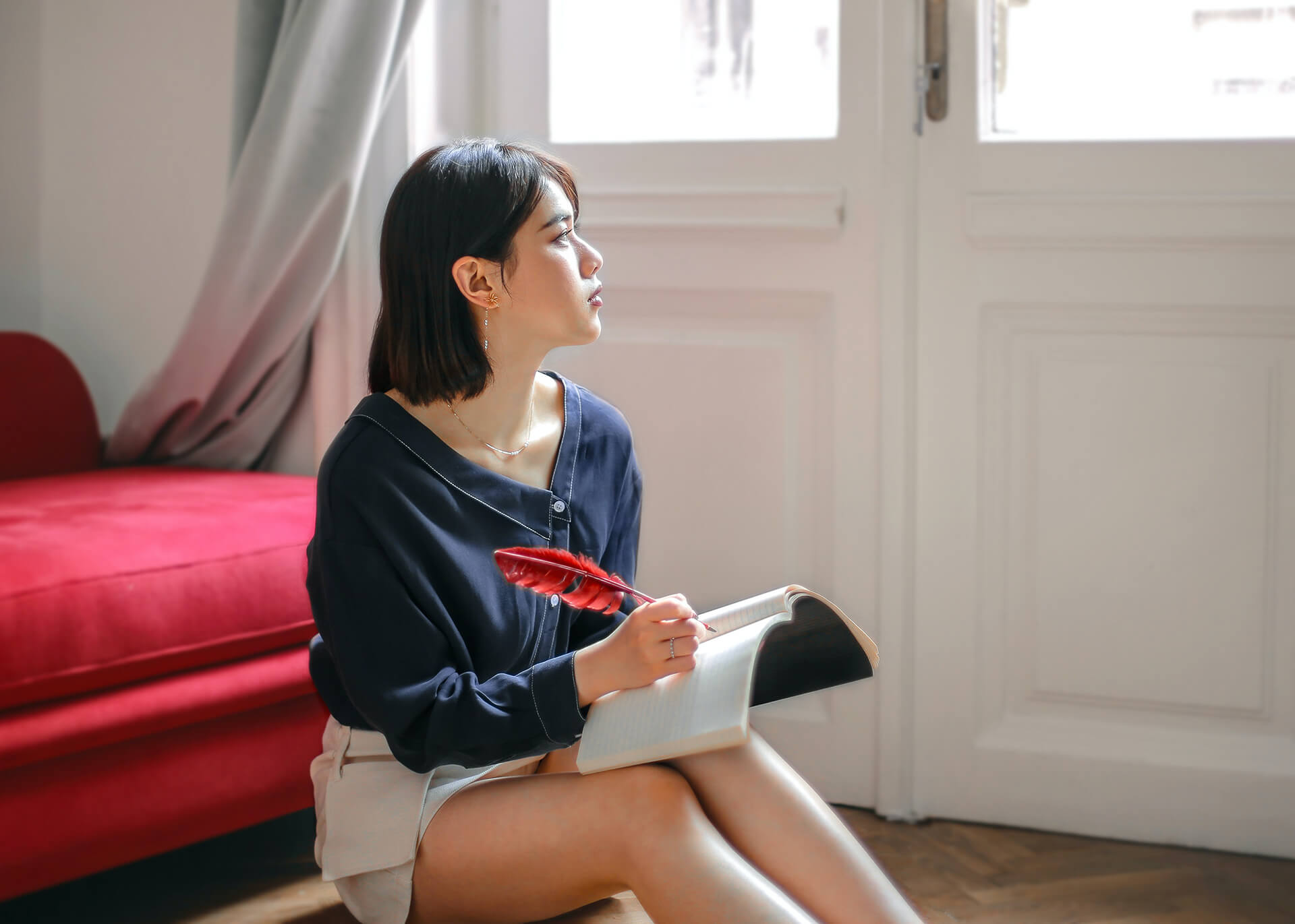 girl writing with feather
