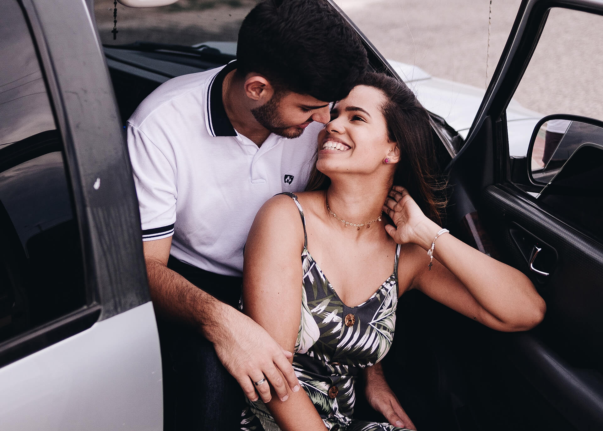 man and woman in a car