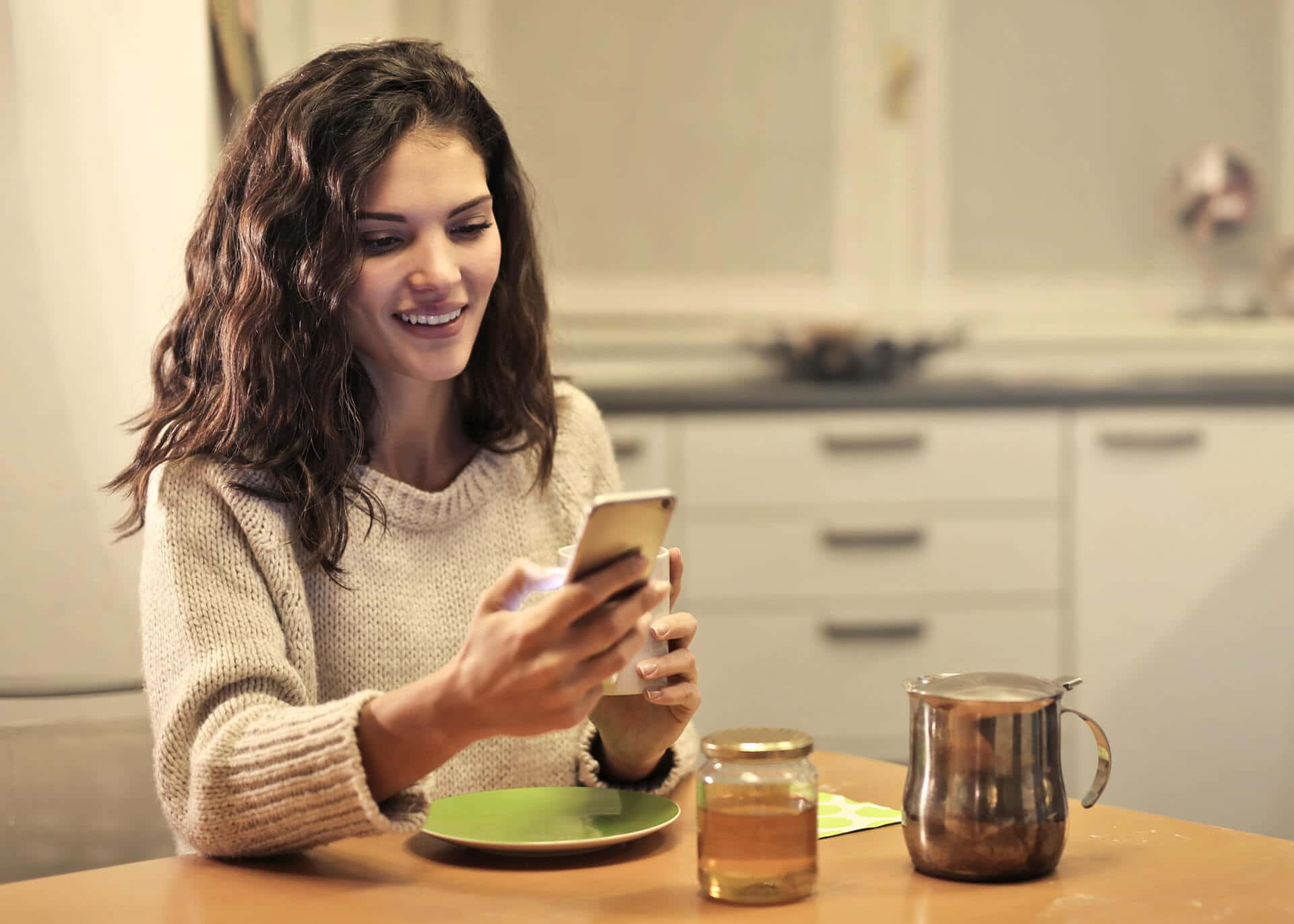 happy woman reading text message