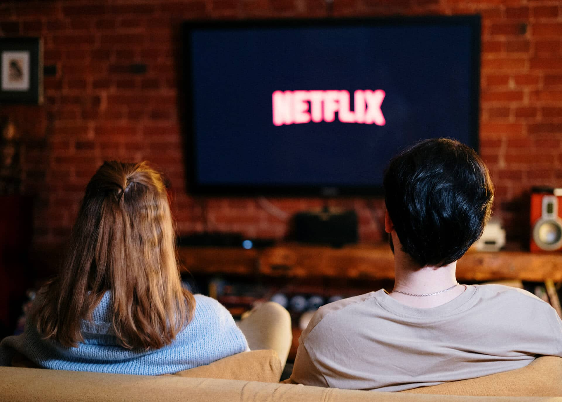 couple at home watching netflix