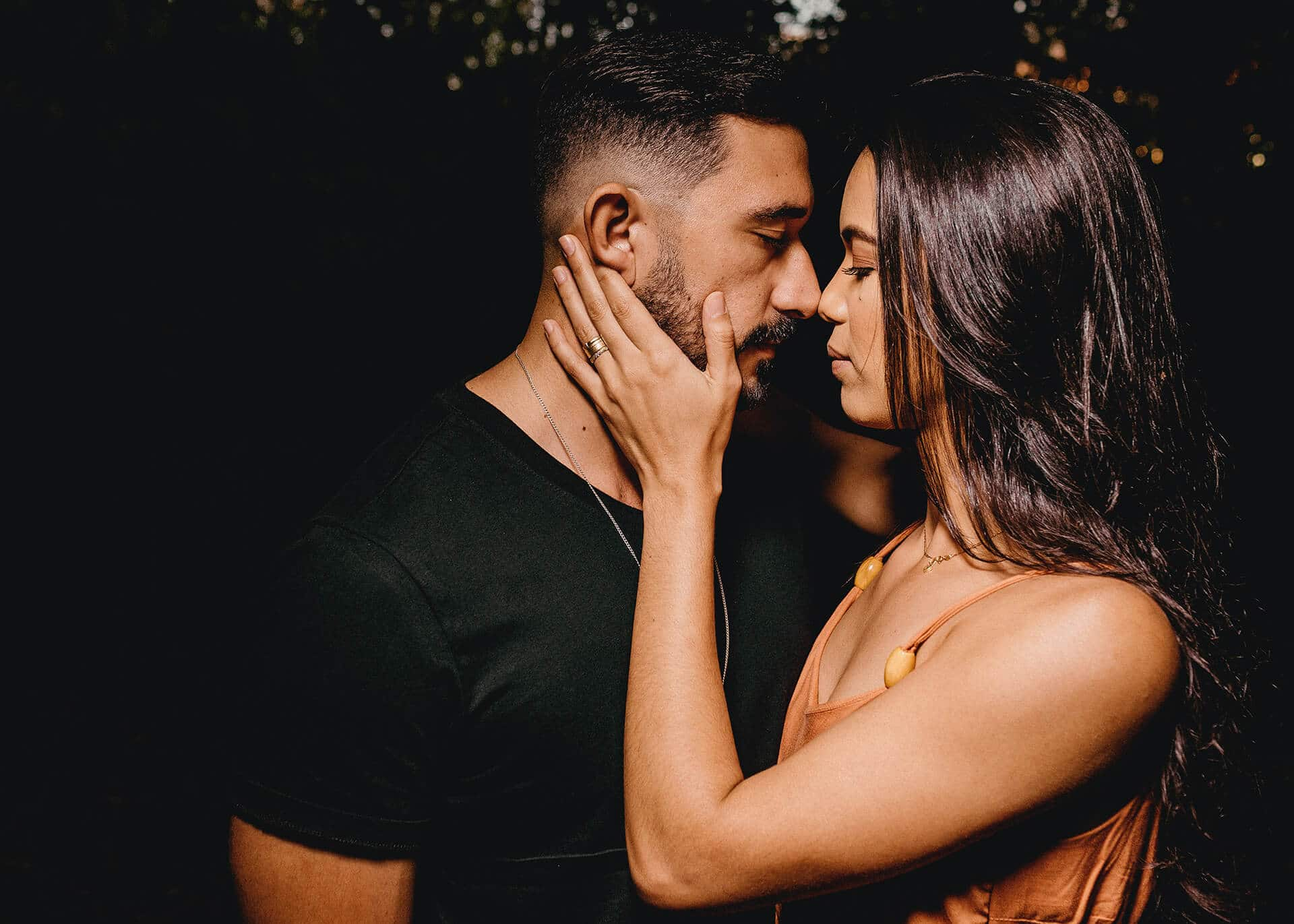 couple standing close and looking at each other