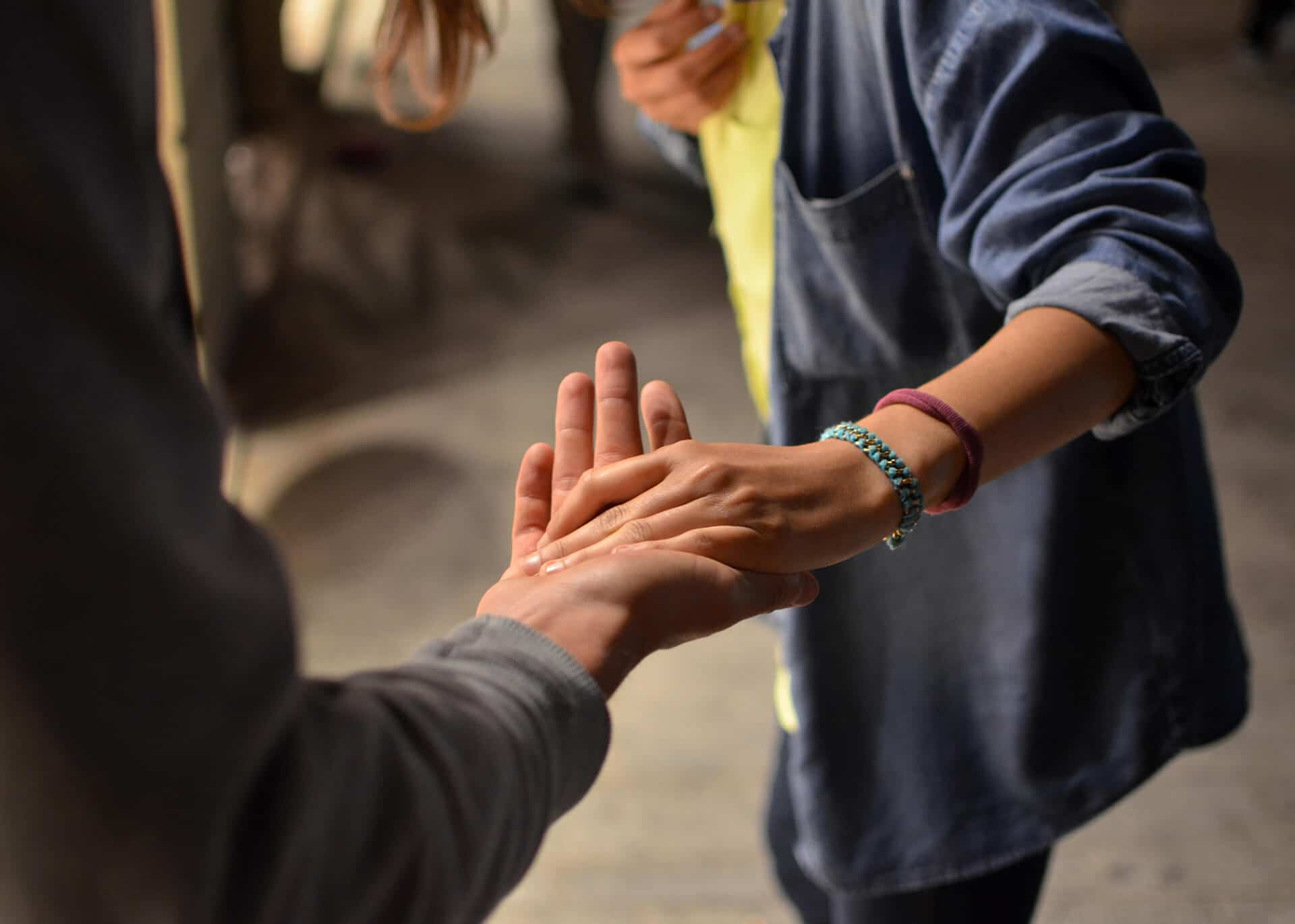 man holding womans hand