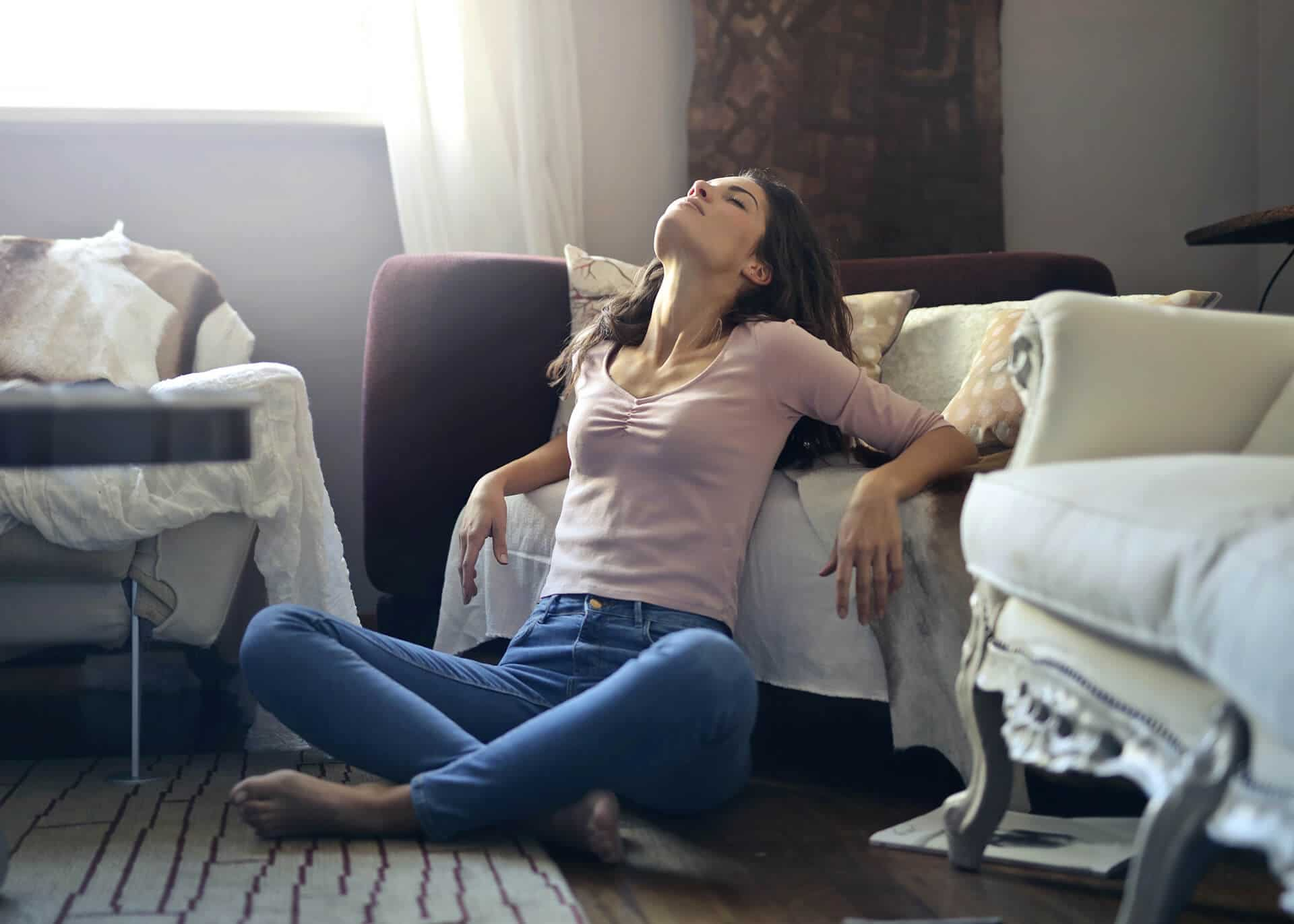 woman sitting on the floor with eyes closed