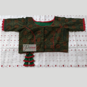 Green Ajrak Blouse With Red Piping And Frill