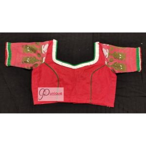 red jamdani body with white green work with 3layer frill blouse