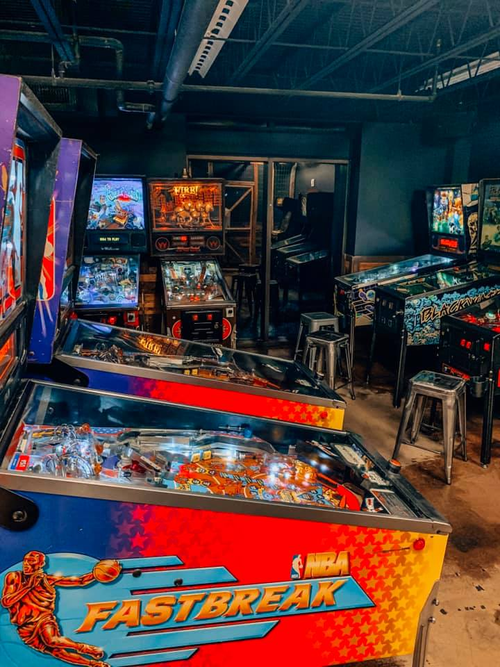 room full of different arcade games, mainly different versions of pinball