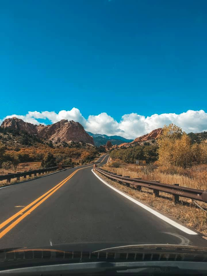 Traveling alone driving down the open roads of Colorado