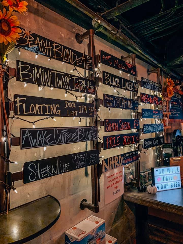 Chalk written names of the tap list, decorated with white lights