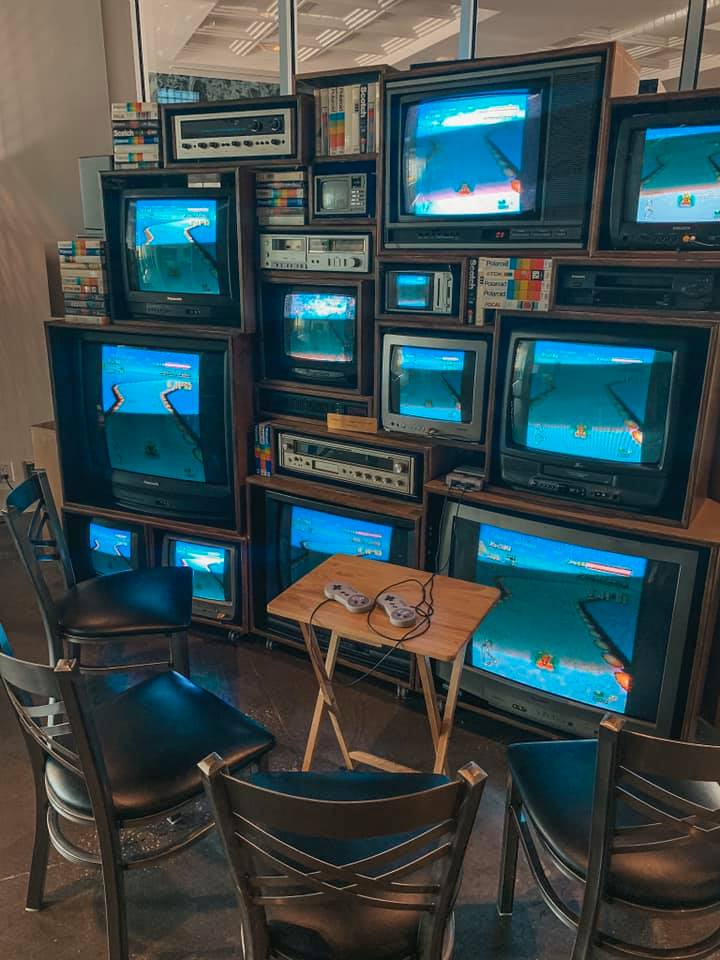 several different sized tvs connected to a classic Nintendo game