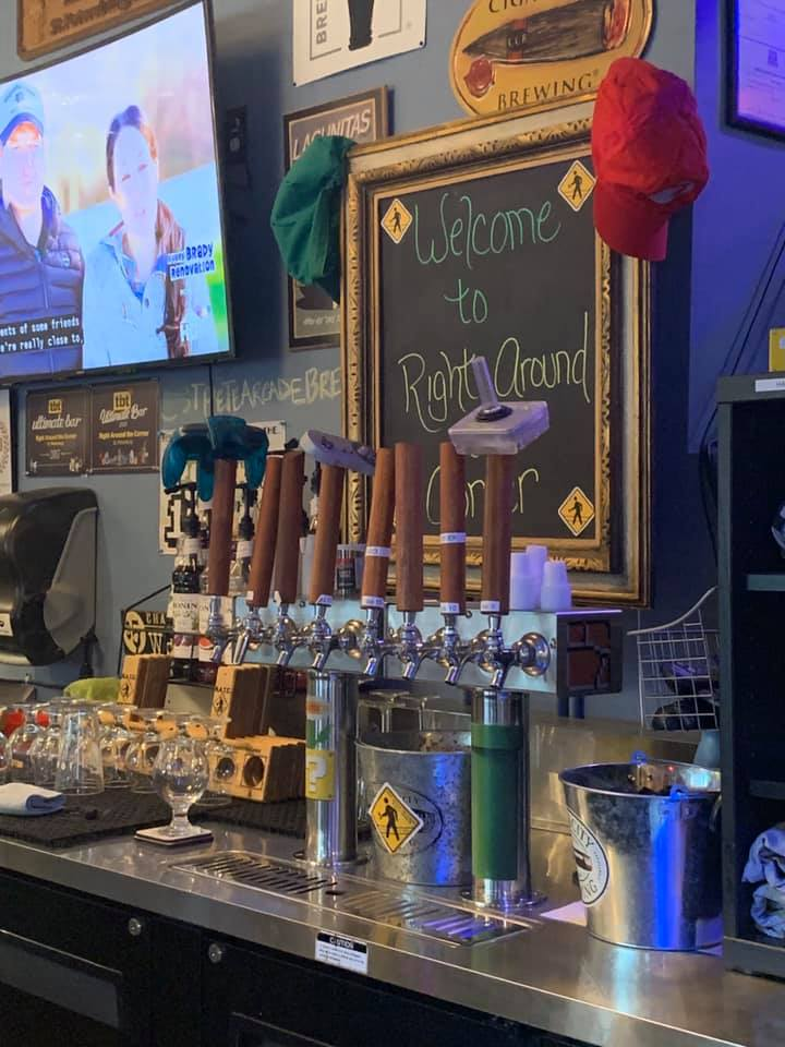 different beer taps, some accented with different game console controllers