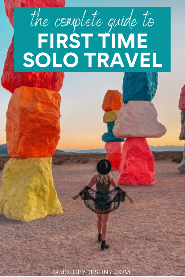 Female solo traveler at Seven Magic Mountains located right outside of Vegas