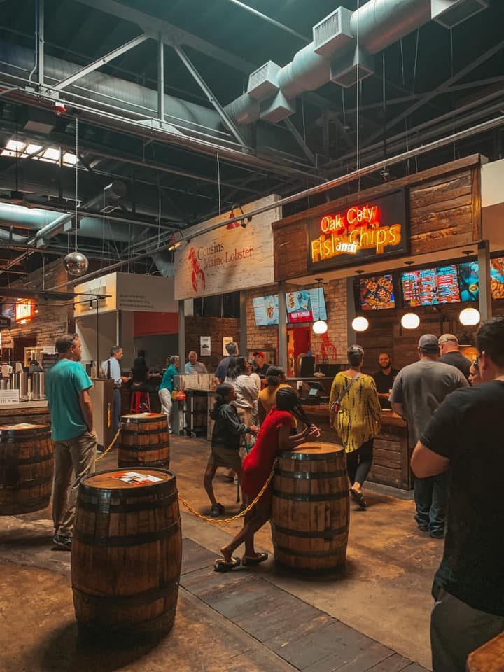 inside of morgan street food hall.  Showing some seating areas as well as vendors