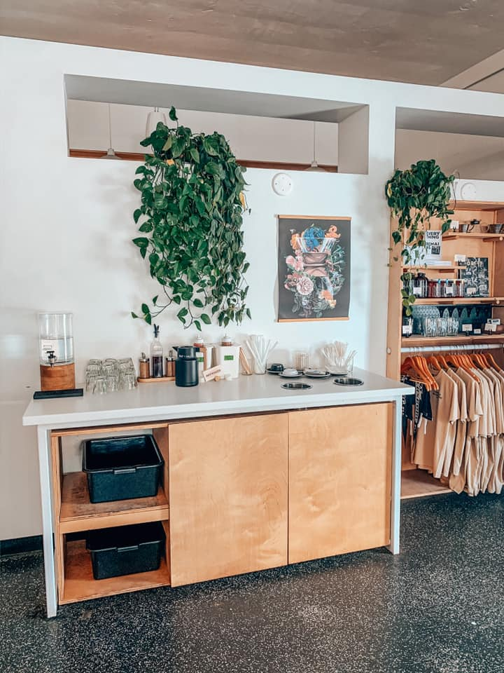 clean interior with some retail items on a rack at Bandit Coffee