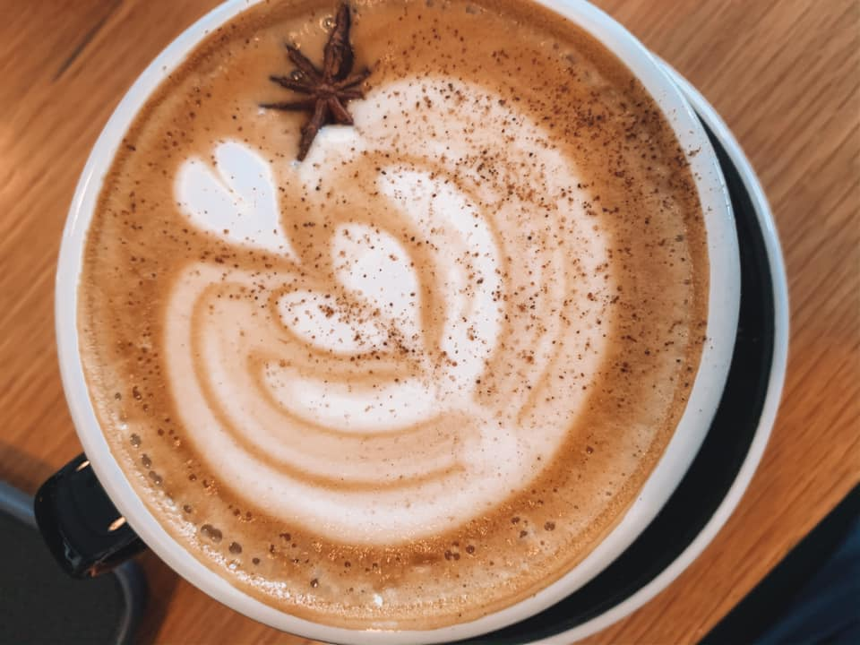 Beautifully crafted latte with a design on the foam at Bandit-- a coffee shop in St. Petersburg, Florida