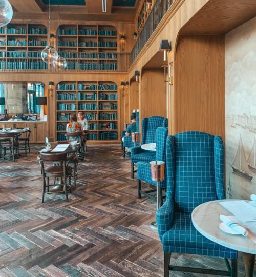 more dining areas and blue books covering shelves at one of st.pete's best coffee shops