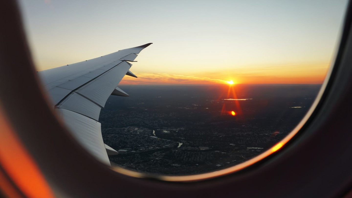 view out of an airplane window. Is it worth getting travel insurance?