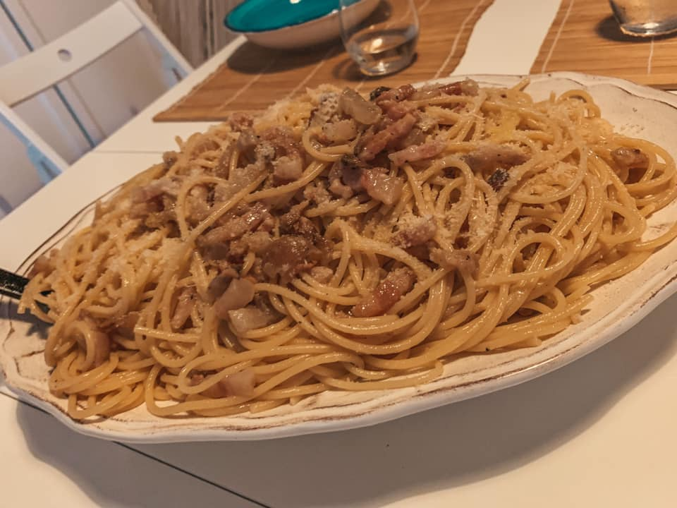 popular foods in Italy, a heaping pile of plated carbonara