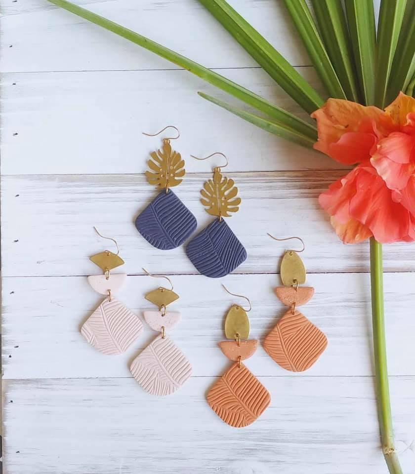 Three sets of Clay Pelican dangly earrings