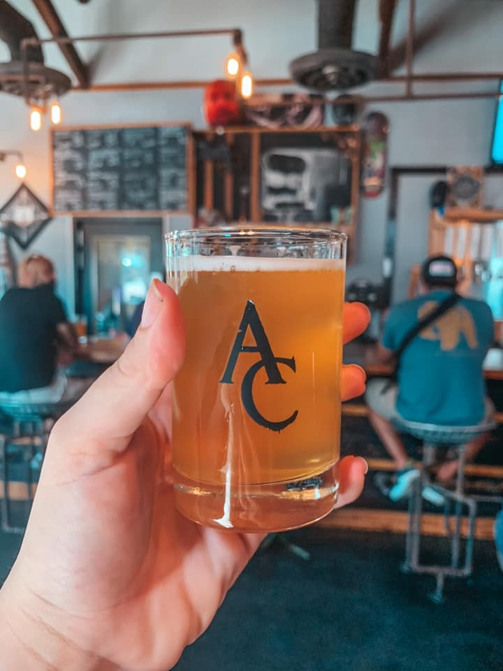 Little beer from Angry Chair Brewing being held up