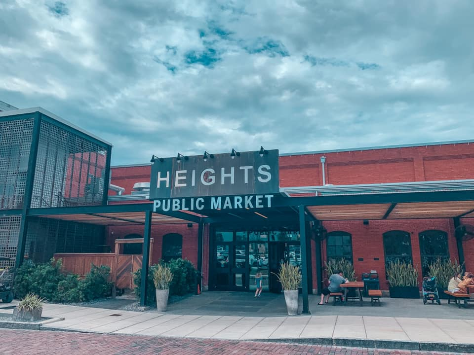 """Outside view of entrance to Armature Works with """"Heights Public Market"""" signage"""