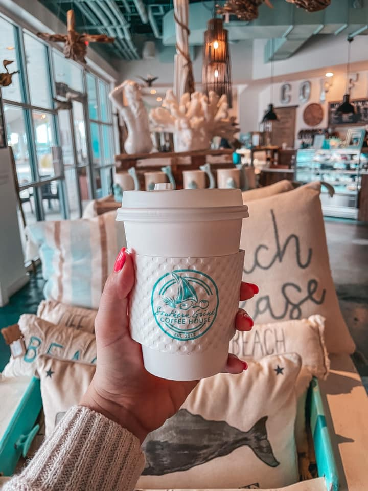 Holding up a cappuccino from Southern Grind
