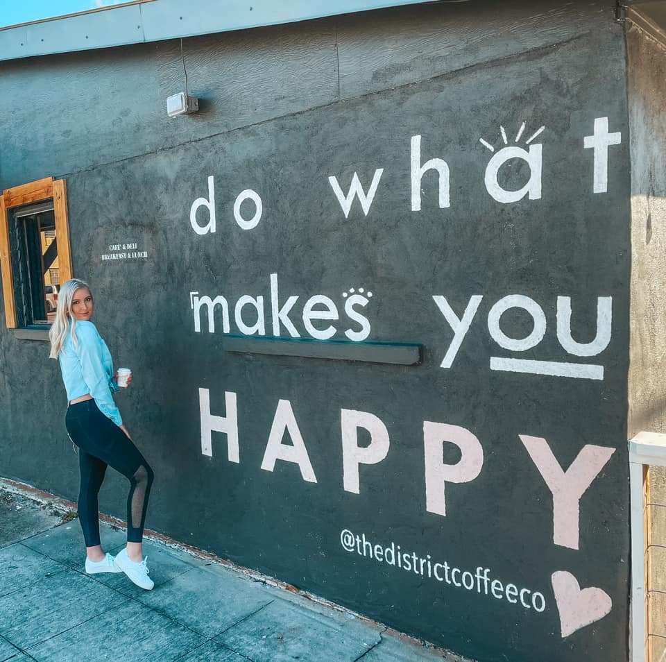 """mural that reads """"do what makes you happy"""" outside of The District Coffee Co"""