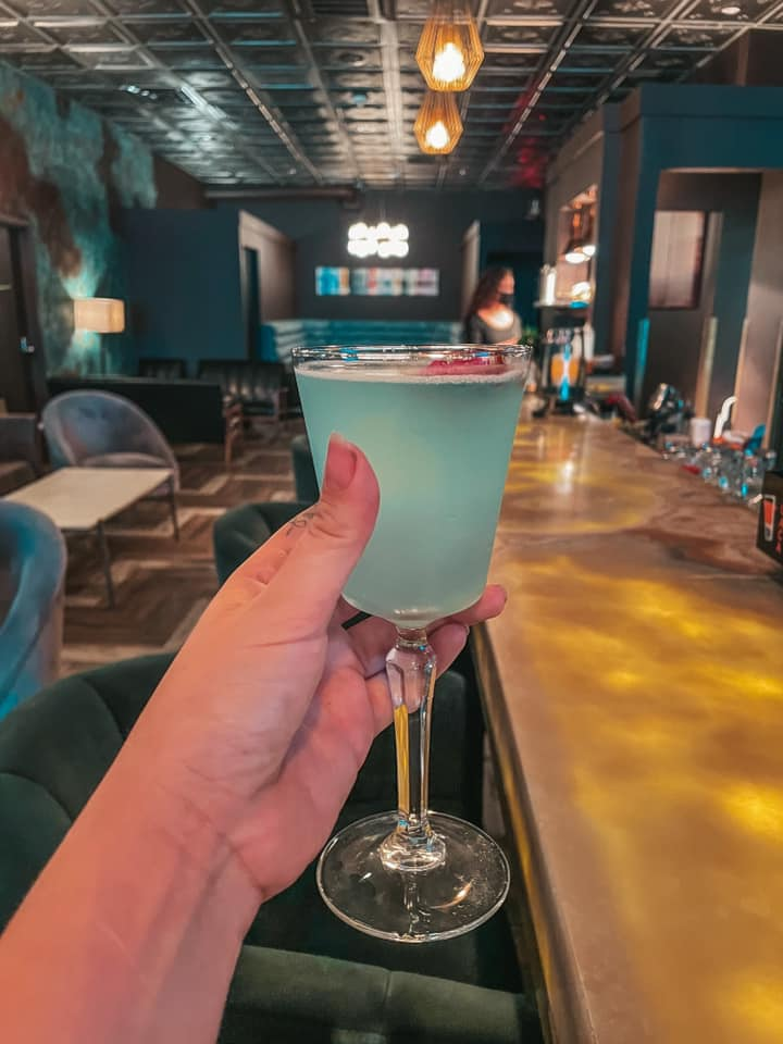 """Beautiful blue cocktail called """"Tropez"""" held up at Tropez in downtown St. Pete"""