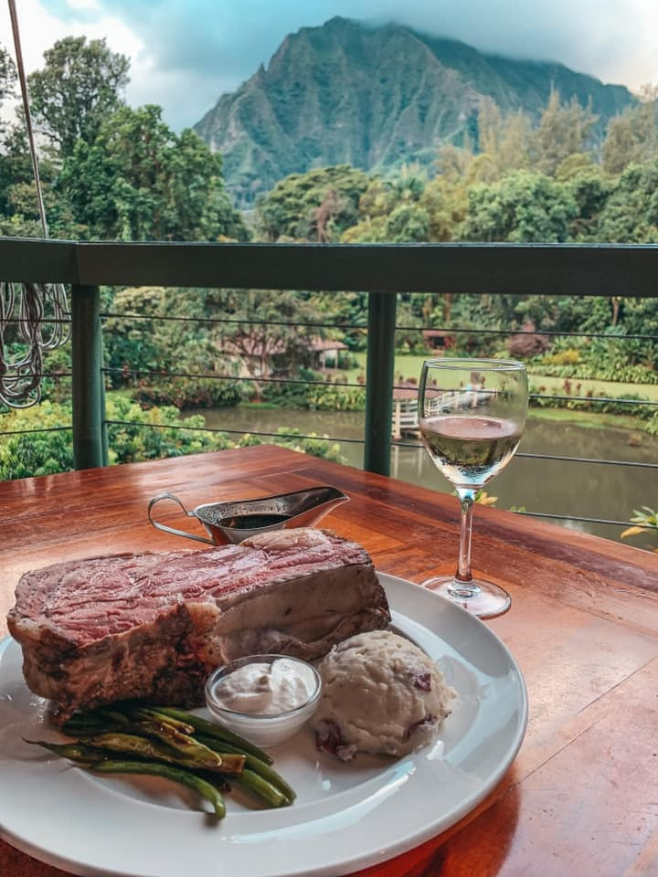 prime rib and glass of wine with mountain views in kaneohe at haleiwa joes