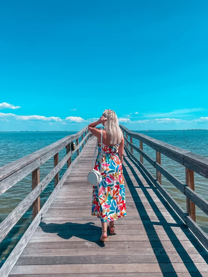 Walking down the Safety Harbor Pier on a sunny, clear sky day