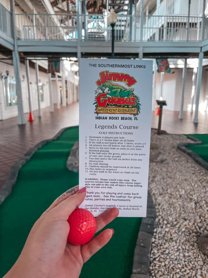 Putt putt rules held up in front of course at Holiday Inn