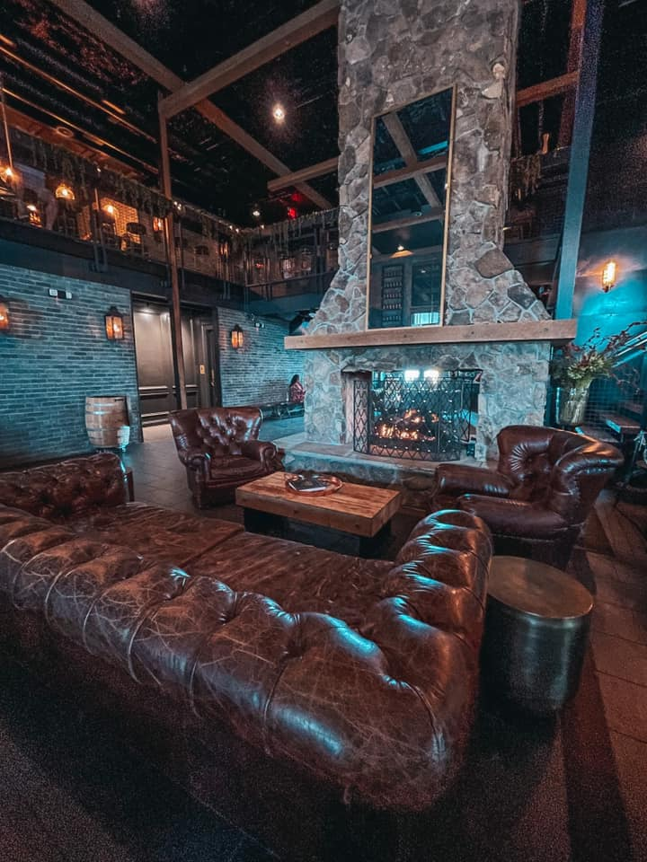 Leather couches and fireplace in The Urban Stillhouse