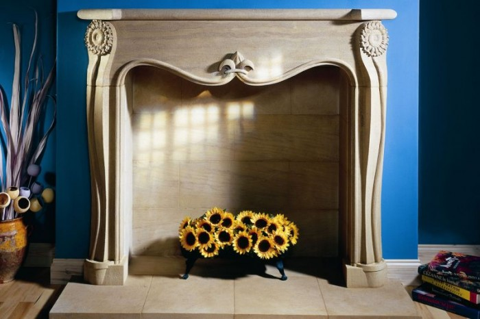interior design with stone - flowers in natural stone fireplace