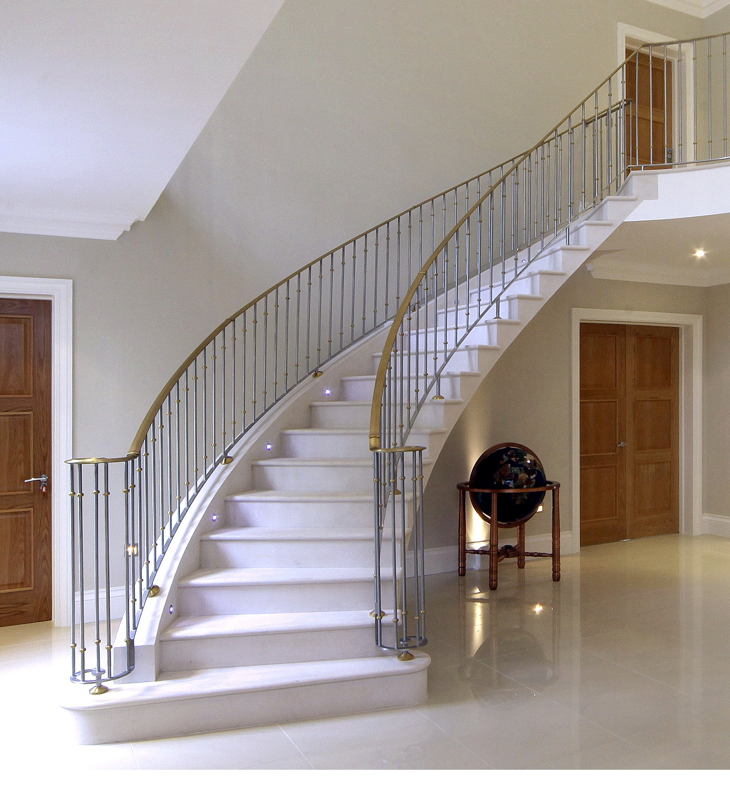 12. Steel-supported honed Moleanos staircase with polished Moleanos stone flooring – Hertfordshire