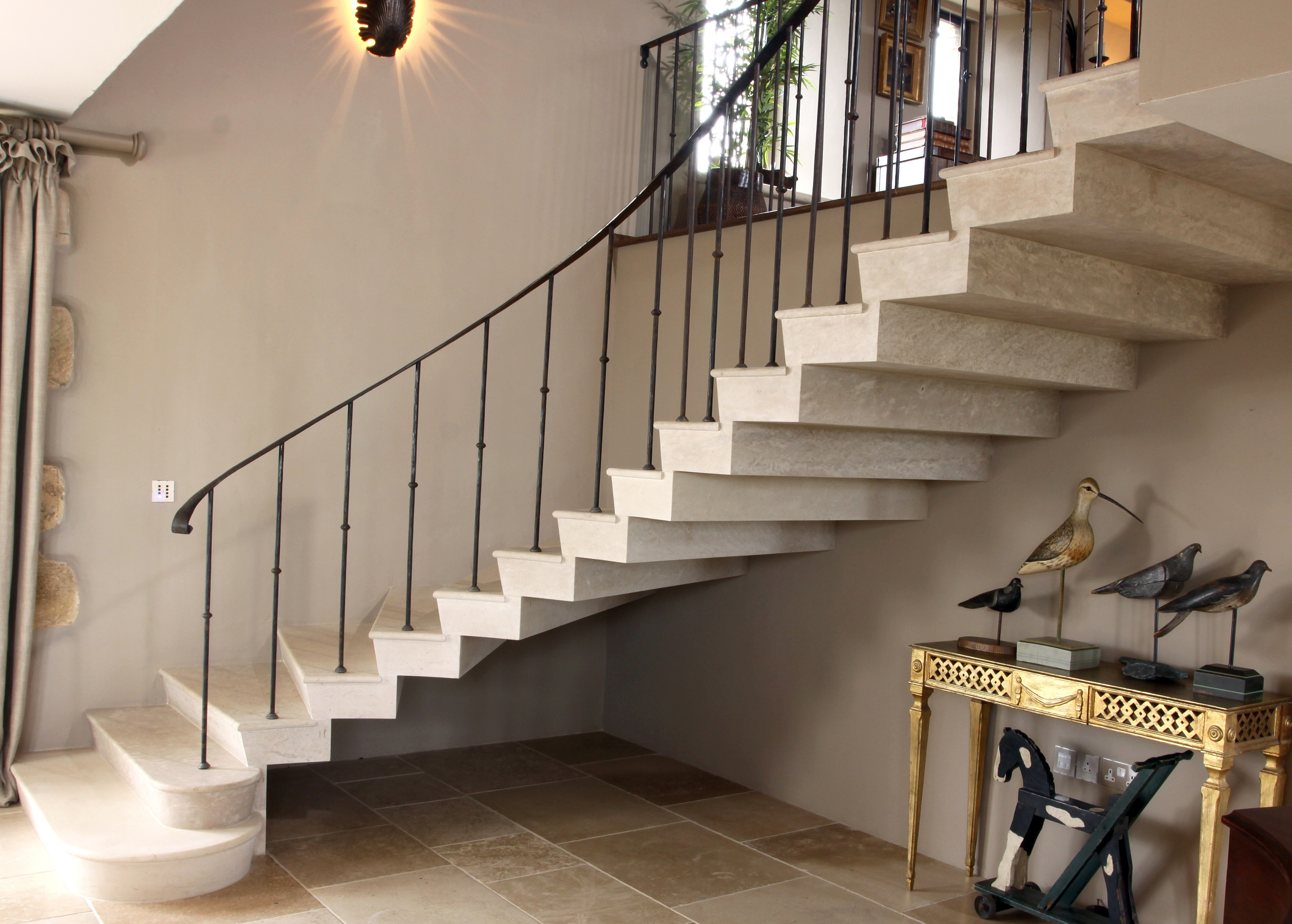 18. Cantilever Roche Marron stone staircase with stepped soffit in a barn conversion – Cotswolds