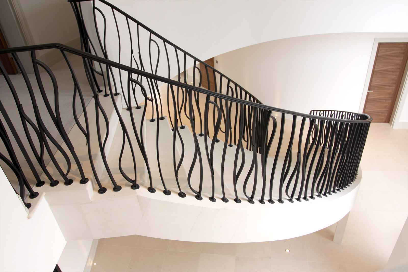 10. Moleanos stone flying staircase with striking metal balustrade and handrail