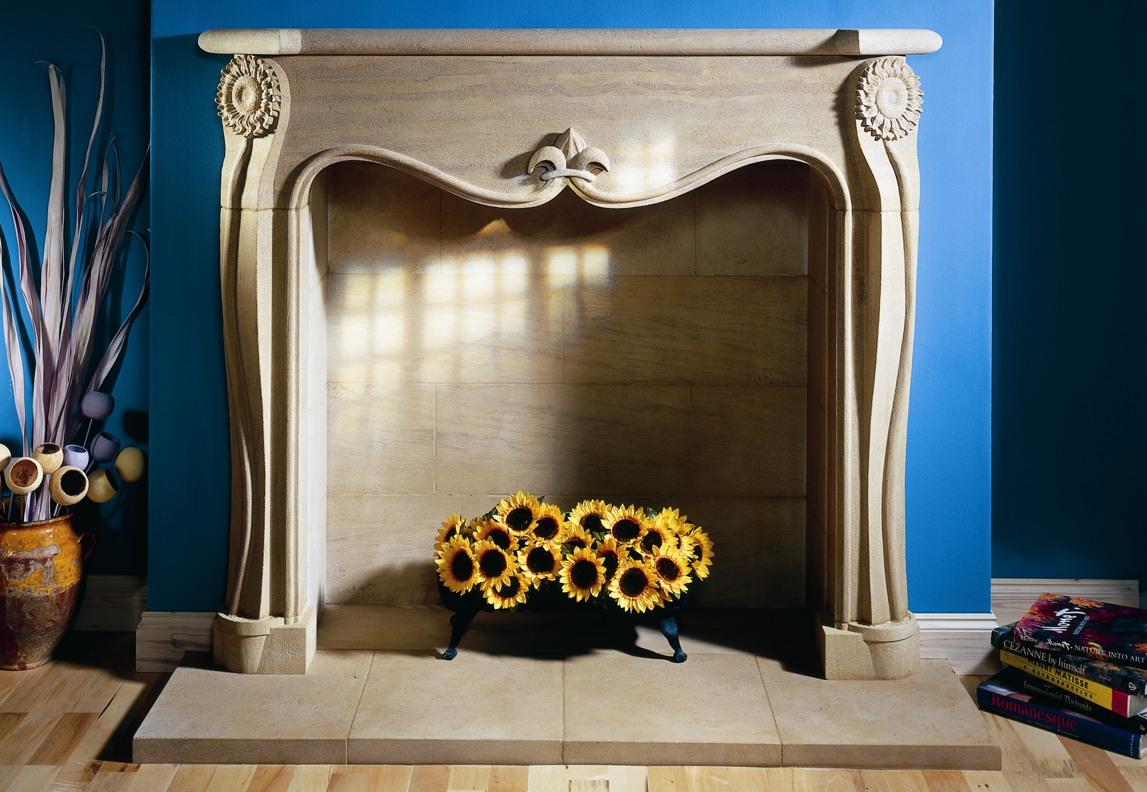 12. Ancaster Hard White stone fire surround with carved sunflower detail – Surrey
