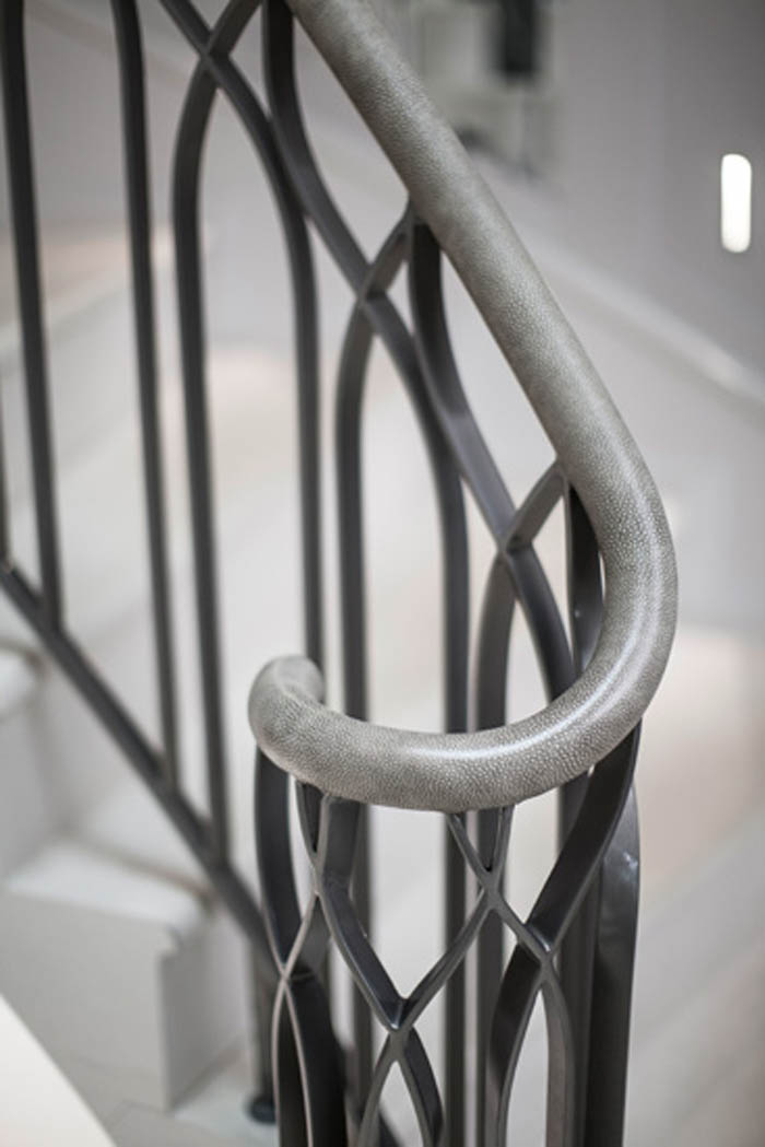 31. Malone stone stair with metal balustrade and leather wrapped handrail – Hertfordshire