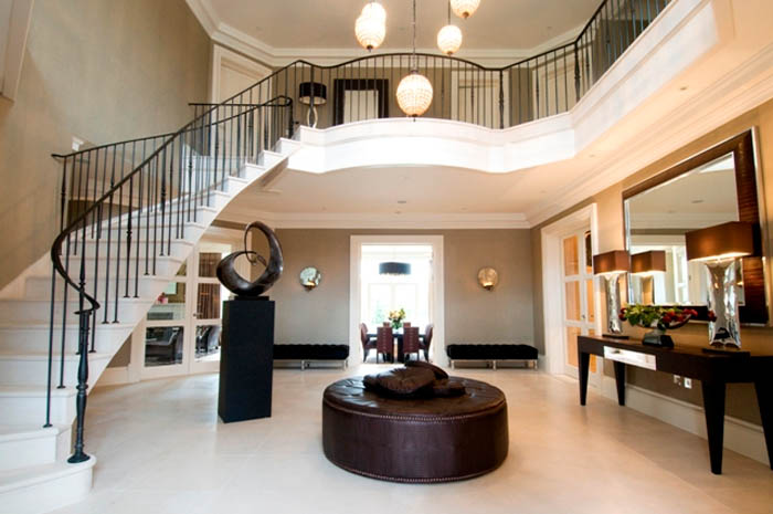 27. Partly steel-supported Moleanos stone staircase with matching flooring – Surrey