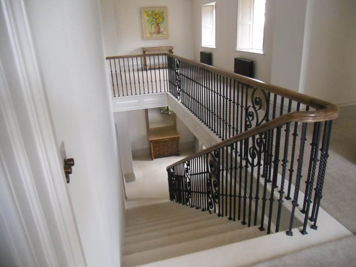 32. Portland stone staircase with metal balustrade and oak handrail – Cotswolds