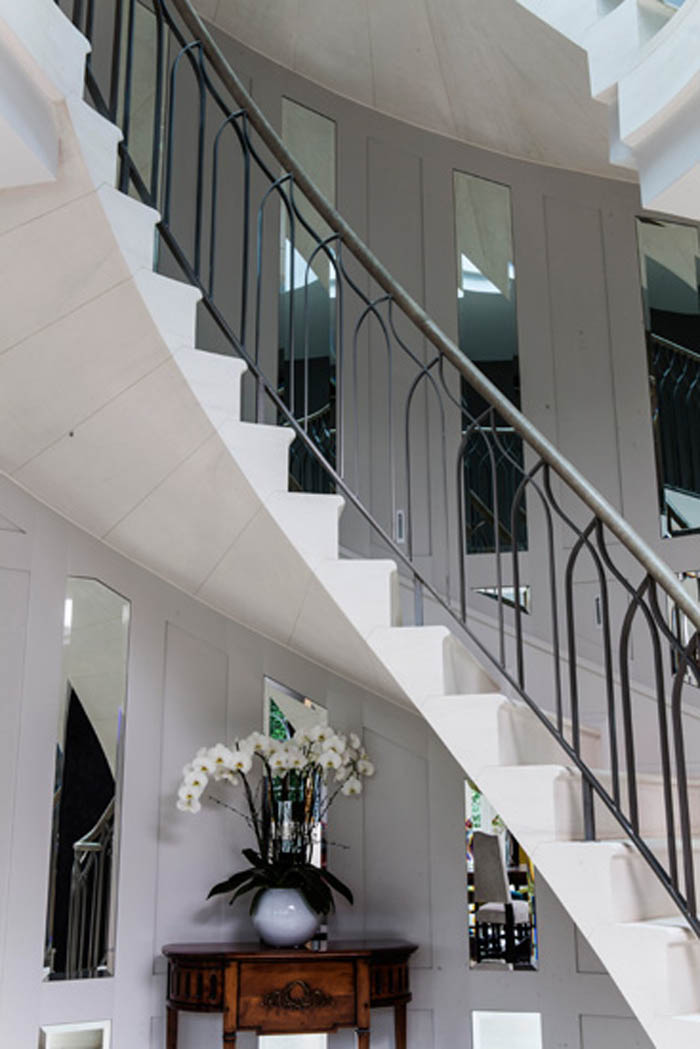 43. Cantilever stone staircase with metal balustrade and leather handrail – Hertfordshire