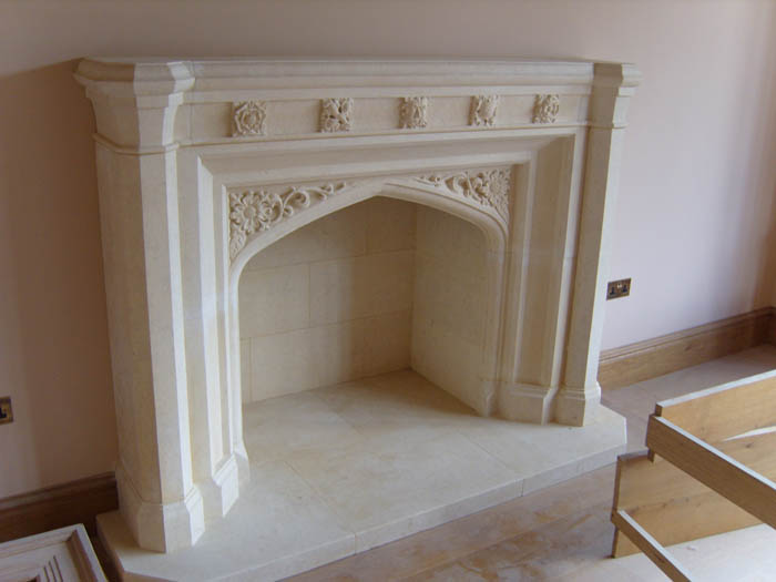 25. Licolnshire stone fireplace with carved gothic detail – Warwickshire