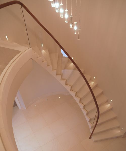 24. Malone stone cantilever staircase with glass balustrade and walnut handrail – Hertfordshire