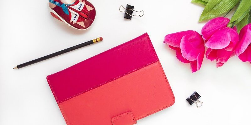 The best tools for bloggers security header image of bright pink notebook and flowers