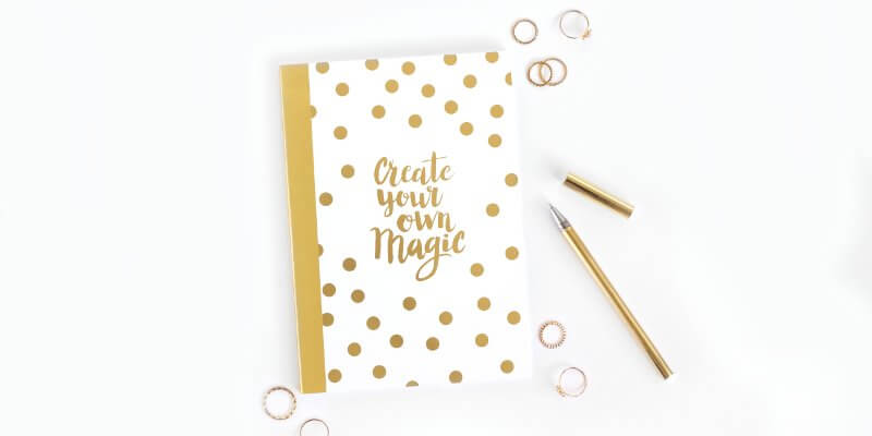 WordPress maintenance task test your website header image of white and gold notebook with pen
