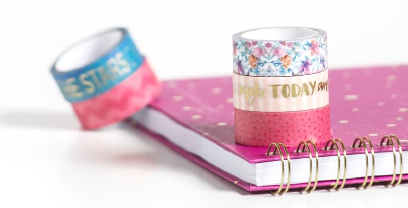 Bright Pink And Gold Notebook With Colorful Rolls Of Washi Tape