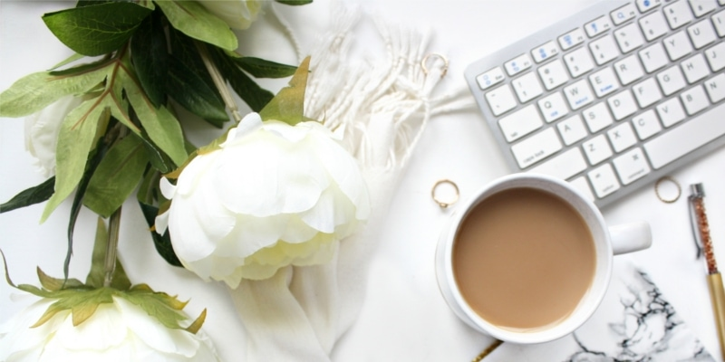 Why Use WordPress For Blogging Header Image Of White Rose Mug Of Coffee And Keyboard