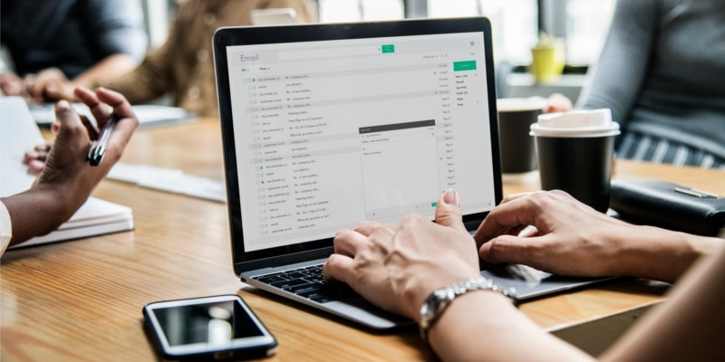 Why Use WordPress Header Image Of Woman Typing On Laptop At Business Meeting Desk